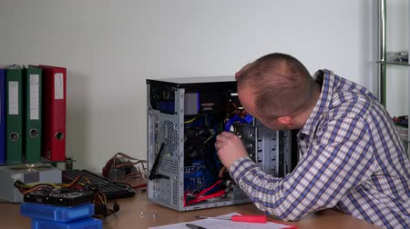 Technician guy upgrading desktop pc ram Stock Footage