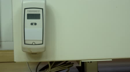 Heating sensor on modern radiator. Numbers changing on electronic device. Stock Footage
