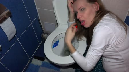 уборная : vomiting woman in bathroom in morning. Sad female sickness in pregnancy time