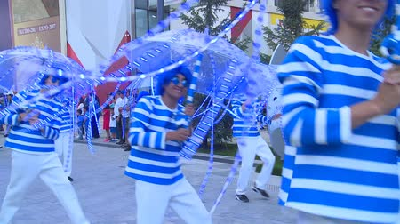ASTANA, KAZAKHSTAN - July 8, 2017: People in blue costumes and umbrella performance in international exhibition expo 2017. Stock Footage