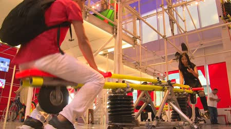 ASTANA, KAZAKHSTAN - July 8, 2017: Young people swing and generate electricity on playground in Expo 2017 Austria pavilion