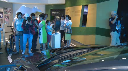 ASTANA, KAZAKHSTAN - July 8, 2017: visitors people taking photos of new hybrid car in Germany pavilion in Expo 2017. Handheld shot Stock Footage