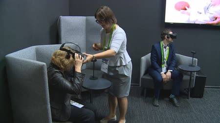ASTANA, KAZAKHSTAN - July 8, 2017: Lithuania pavilion guide put virtual reality VR headset glasses during international exhibition Expo 2017. Handheld shot. Wideo