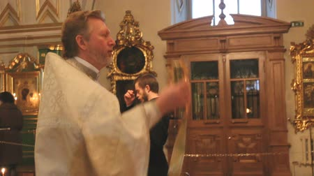 potvrzení : the priest in the Church a prayer in St. Nicholas Cathedral