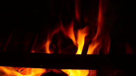 aglow : fire with charcoal in a dark room with a grate for cooking Stock Footage