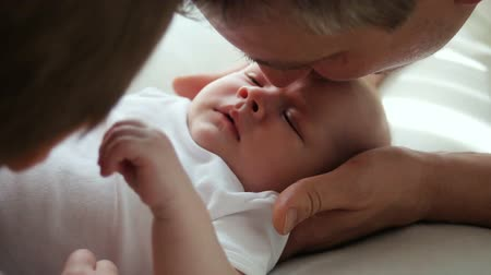 paternal : father kissing newborn son Stock Footage