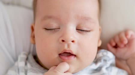 eyes closed : baby boy falls asleep on hands Stock Footage