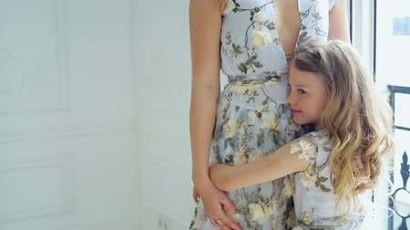 same : my daughter hugs mother in a long floral