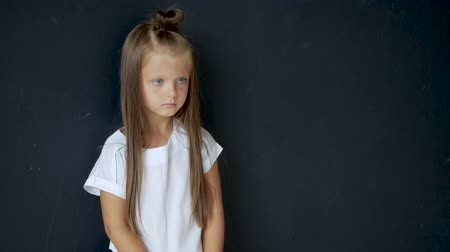 ventoso : portrait of serious girl looking forward