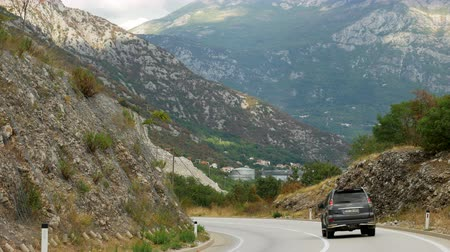 углы : Perast, Montenegro - September 26: red passenger car rides through the mountains in the European day of languages on September 26, 2017