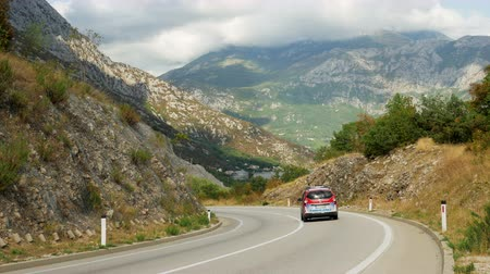 absorption : Perast, Montenegro - September 26: ambulance red passenger car rides through the mountains in the European day of languages on September 26, 2017