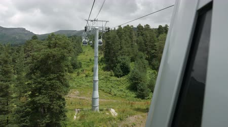 wynalazek : Arkhyz, Karachay-Cherkessia - July 19: view from the cabin on the cable car passing over the mountainsin the European day of languages on July 19 2018