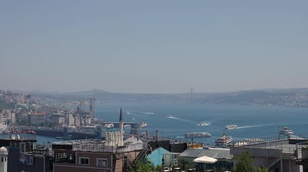 kablo : Turkey, Istanbul - 5 June 2019: view of the Bosphorus Strait with floating ships and houses from the mosque on a sunny summer day June 5, 2019