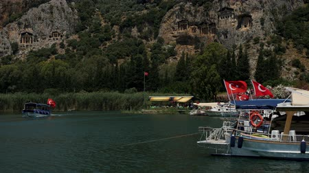 Dalyan, Turkey - 9 June: boat with roof floating on the river in Dalyan Turkey on a summer day June 9, 2019 Stok Video