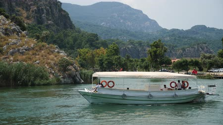 estreito : Dalyan, Turkey - 9 June: excursion boat with people floating on a narrow river in the summer June 9, 2019