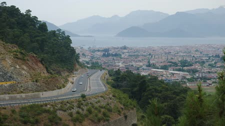 observation deck : Marmaris, Turkey - 9 June: view of the city and the road with cars in the daytime from the observation deck on the mountain June 9, 2019