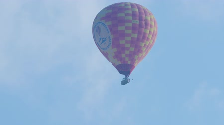 valley of fire : Turkey, Pamukkale - 12 June 2019: Hot air balloon striped with a basket of tourists flying high in the sky on Pamukkale Turkey June 12, 2019