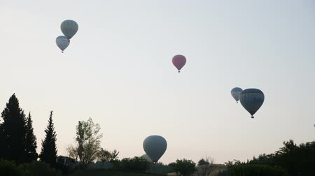고대 : Turkey, Pamukkale - 12 June 2019: Hot air colorful balloon fly over the white limestone mountains in the morning on a warm summer day June 12, 2019 무비클립