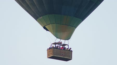 Turkey, Pamukkale - 12 June 2019: Hot air colorful balloon fly over the white limestone mountains in the morning on a warm summer day June 12, 2019 Stock mozgókép