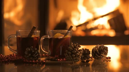 barmetro : Mulled wine glasses on the table in front of the burning fireplace.