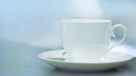 caffe : Steam from a cup with a hot coffee. Coffee or Tea.