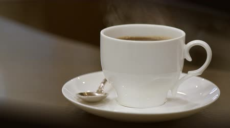 caffe : Pouring coffee into cup. Steam from a cup with a hot coffee.
