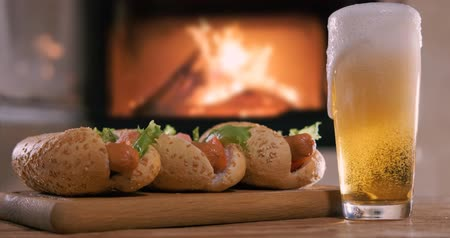 fireplace : Cinemagraph - Hotdogs with beer. Stock Footage