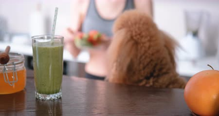 cucumber : Young woman eating salad after a workout. Stock Footage