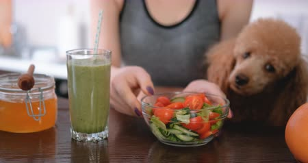 Young woman eating salad after a workout. Dostupné videozáznamy