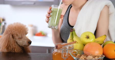 Young woman drinking smoothie after a workout. Dostupné videozáznamy