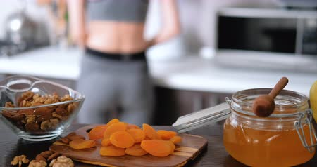 Woman is prepare healthy food after a workout. Wideo