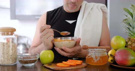 Adult man eating after workout. Dostupné videozáznamy