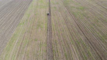 Above view of tractor plowing the field, spring working