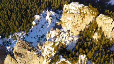 Flying above rocky mountain. Ladys Stones in Rarau mountains, aerial winter view of Rarau top.
