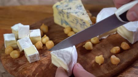mold : cut the Camembert cheese on wooden Board