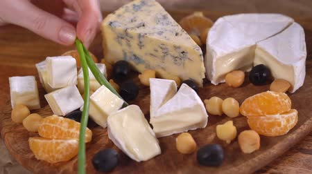 mold : Put greens on a Serving Board with cheese. Stock Footage
