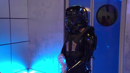 戦闘 : Darth Vader at a childrens party. Laser tag 動画素材