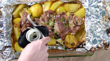 parsley : baked in foil pork neck, potatoes sprinkled onions
