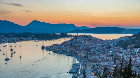 sea port : Panoramic aerial view of Poros, Greece - Timelapse of summer sunset Stock Footage