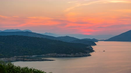 görög : Panoramic view of sunset on small island Poros, Greece - Timelapse of summer sunset
