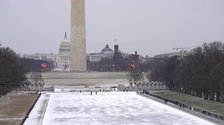 architectural monument : Winter Washington DC: washington monument and US Capitol at snowy day