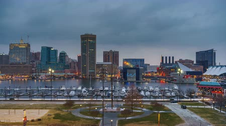 md : Day to night timelapse of Baltimore skyline and Inner Harbor from Federal Hill, Baltimore, Maryland