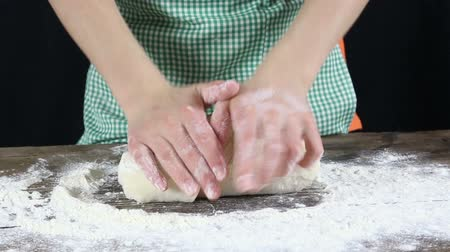 хлеб : Girls hands mixing the dough on wooden table