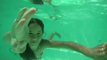 swimming underwater : Girl diving in swimming pool