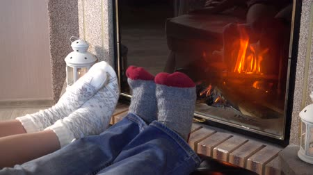 sock : Moving legs in woolen socks heat up near fireplace