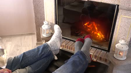 sock : wiggling legs in woolen socks heat up near fireplace