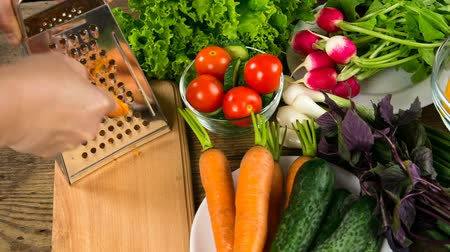 rabanete : Assortment of vegetables on wooden table with grater Stock Footage