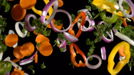 chop up : Falling cuts of plenty colorful vegetables, slow motion Stock Footage