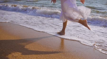 отдыха : girls feet running on the surf, slow motion