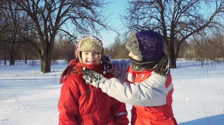 házení : Two funny kids playing together at snow